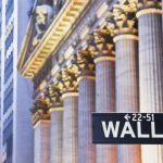 Manhattan, New York, New York, USA --- Wall Street Sign and New York Stock Exchange --- Image by © Rudy Sulgan/Corbis